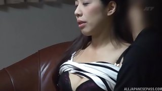 Skinny Japanese girlfriend gets licked and fucked on someone's skin sofa