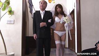 Inferior Asian bride gives a blowjob at the altar
