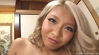 Cute blonde Asian chick gets nude for a man's hard prick