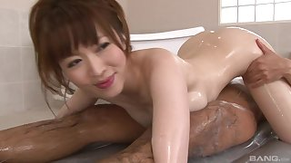 Soapy Japanese enjoys to deprecation two sticky penises at the same time